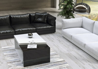 rendering di un salotto a doppia altezza con divani
